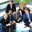 Satisfied proud business team looking at camera and smiling in office — Stock Photo
