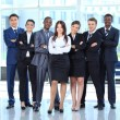 Happy young business woman with her team in background — Stock Photo #11832181