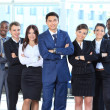 Portrait of businessman leading his team at office — Stock Photo #11832214