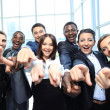 Portrait of excited young business pointing at you - Stock Photo