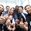 Happy multi-ethnic business team with thumbs up in the office — Stock Photo