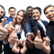 Happy multi-ethnic business team with thumbs up in the office — Stock Photo #11832244