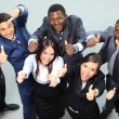 Top view of executives smiling and pointing — Stock Photo