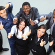 Top view of executives smiling and pointing — Stockfoto