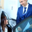Woman buying a new car - Stockfoto