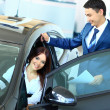 Woman buying a new car — Stock Photo #11832319