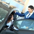 Woman buying a new car — Stock Photo #11832328