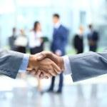 Business handshake and business — Stock Photo