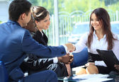 Happy smiling businesswoman shaking hands after a business meeting — Stock Photo