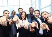 Portrait of excited young business pointing at you — Stock Photo