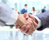 Business handshake and business — Photo