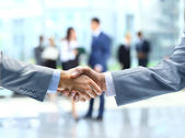 Business handshake and business — Stock Photo