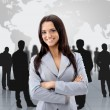 Happy young business woman standing in front of her team — Foto Stock