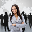 Happy young business woman standing in front of her team — Stock Photo #12374601