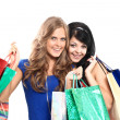 Group of two happy young adult women out of shopping with colored bags — Stock Photo #12375937