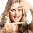 Young woman frame her face with hands - Stock Photo