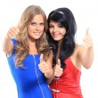 Two young women showing thumbs up — Stock Photo #12376187
