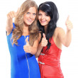 Stock Photo: Two young women showing thumbs up