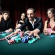 "Poker player going ""all in"" pushing his chips forward — Stok fotoğraf"