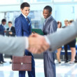 Handshake in front of business — Stockfoto #12377299