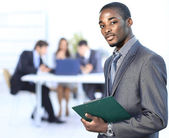 Portrait of a successful american african businessman smiling leading his team — Stock Photo