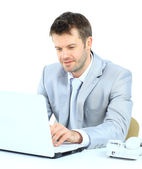 Portrait of young confident business man with laptop — Stock Photo