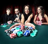 Young beautiful woman playing in casino — Stock Photo