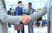 Handshake in front of business — Photo