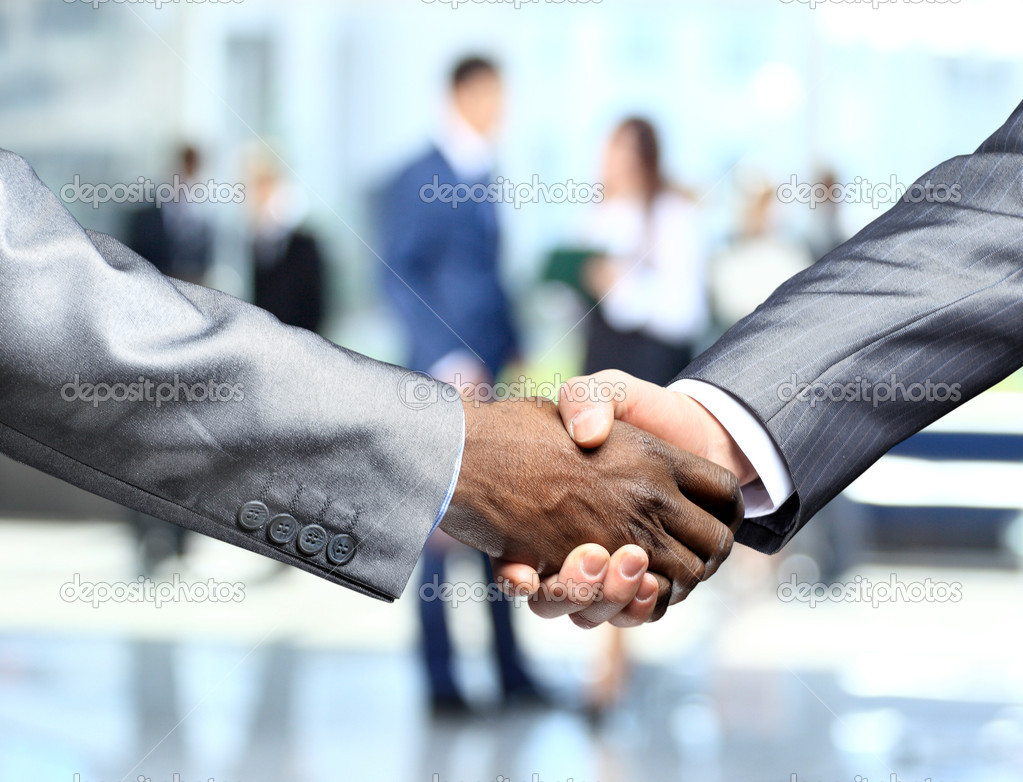 Handshake in front of business — Stock Photo #12375119