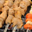 Shish Kebabs, Onion and Tomato Being Cooked on Skewers — Stock Photo