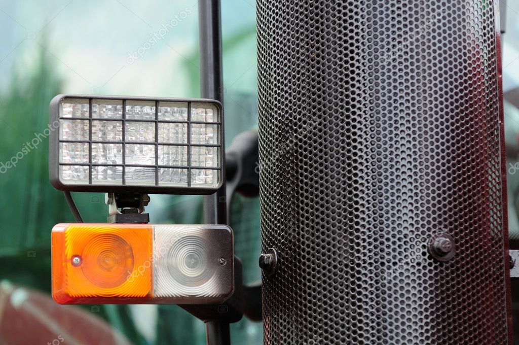 Tractor headlights and a grill covering the exhaust pipe — Stock Photo #11022857