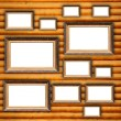Blank Picture Frames on Wooden Wall - Stock Photo