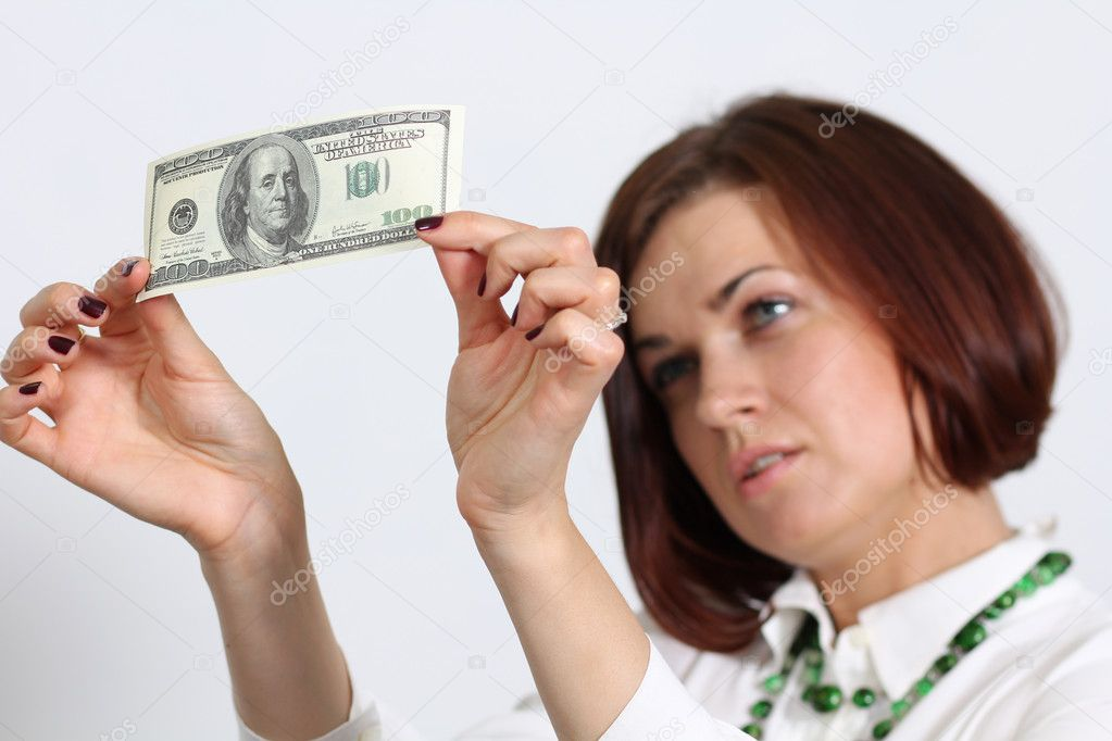Young woman holding a 100 dollar bill  Stock Photo #10866989