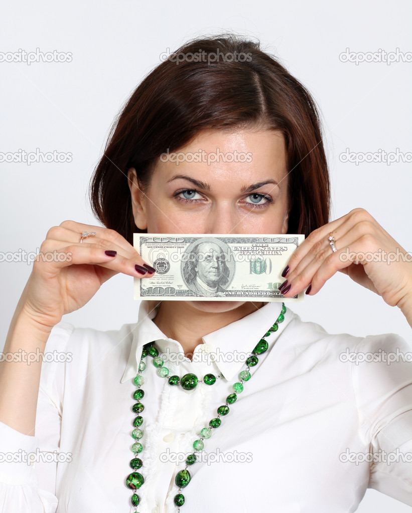 Young woman holding a 100 dollar bill — Stock Photo #10867005