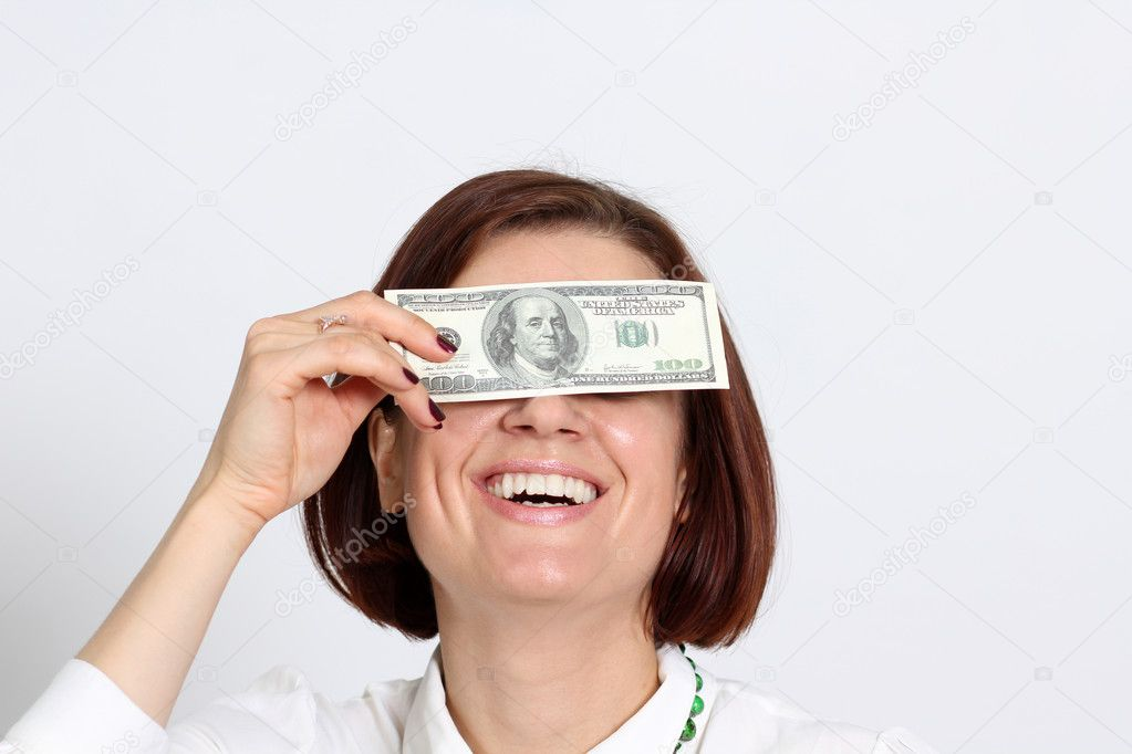 Young woman holding a 100 dollar bill — Stock Photo #10867016