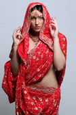 Pretty woman in indian red sari — Stock Photo