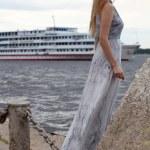 Sad woman standing on the shore — Stock Photo
