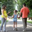 Family of four enjoying outdoors - Stockfoto
