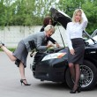Young women with broken car - Stock Photo