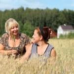 Portrait of an elderly women in a wheat field — Stock Photo #11798912