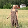 Stock Photo: Portrait of an elderly woman in a wheat field
