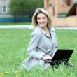 Stock Photo: Young blond having fun with laptop outdoors