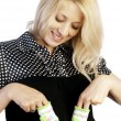 Pregnant woman holding baby's socks on her belly - Stock Photo