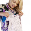 Charming young pregnant woman prepares to become a mother - Stock Photo