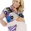 Charming young pregnant woman prepares to become a mother — Stock Photo