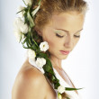 Beautiful young woman with fresh spring flowers in her hair — Stock Photo #11121198