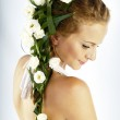 Beautiful young woman with fresh spring flowers in her hair — Stock Photo #11121202
