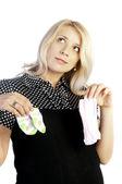 Pregnant woman holding baby's socks — Stock Photo