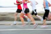 Koşucular, bulanık hareket — Stok fotoğraf