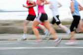 Runners, blurred motion — Stock Photo